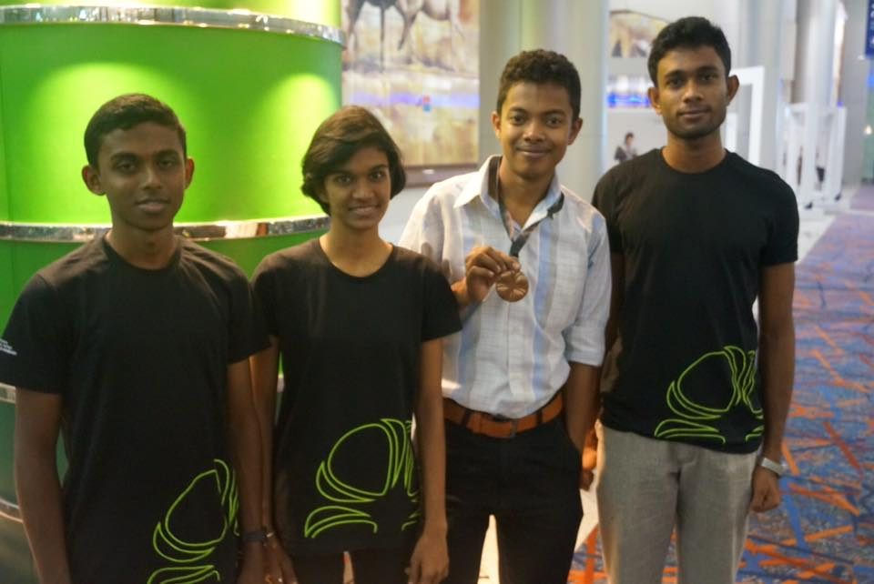 Sri Lankan students with Medal winner sharaka